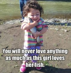 You will never love anything as much as this girl loves her fish.